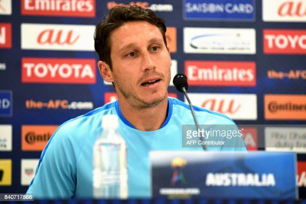 Australia's Mark Milligan answers questions during a press conference at Saitama Stadium in Saitama on August 30 2017 Australia will play Japan in a...