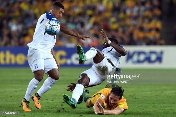 TOPSHOT Australia's Mark Milligan collides with Honduras' Johnny Palacios and Bryan Acosta during their 2018 World Cup qualification playoff football...