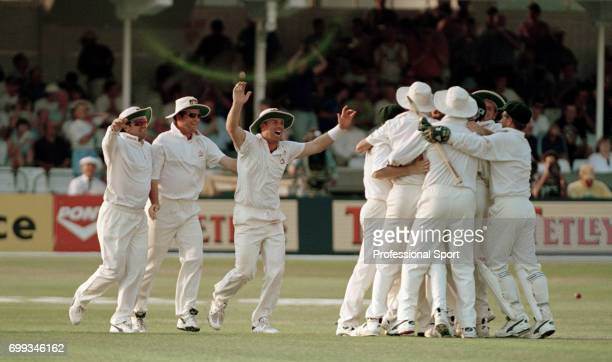 Australia's Mark Taylor Mark Waugh and Shane Warne go to celebrate with the rest of the team after Australia win the 5th Test match between England...