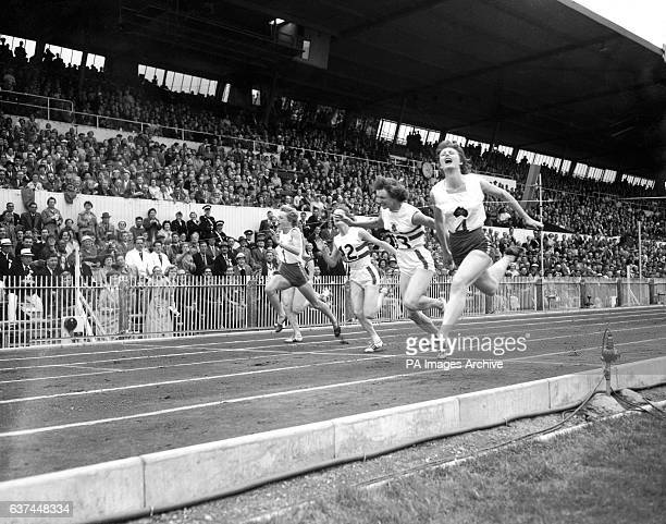 Australia's Marlene Mathews wins gold in the women's 110yds final from teammate Betty Cuthbert and Great Britain's Heather Armitage and Madelaine...
