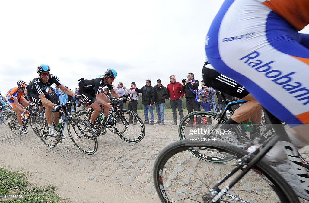 Australia's Mathew Hayman (L) and Germany's Ian Stannard (team Sky Procycling) take a curve on a cobblestoned road during the 110th edition of the Paris-Roubaix one-day classic cycling race on April 8, 2012, in Roubaix, northern France. Boonen, who had previously won in 2005, 2008 and 2009, equals the record of wins in Paris-Roubaix held by compatriot Roger De Vlaeminck. Boonen won the race ahead of French Sebatsien Turgot (Team Europcar) and Italy's Alessandro Ballan (Team BMC).
