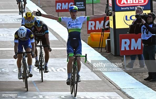 Australia's Mathew Hayman celebrates as he crosses the finish line ahead of Belgium's Tom Boonen Great Britain's Ian Stannard and Belgium's Sep...