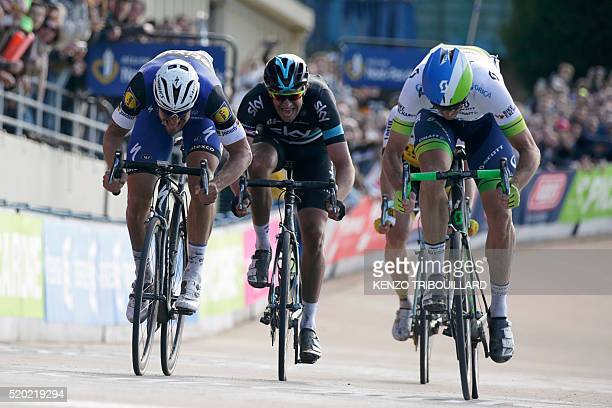 Australia's Mathew Hayman sprints to win ahead of Belgium's Tom Boonen and Great Britain's Ian Stannard at the end of the 114th edition of the...