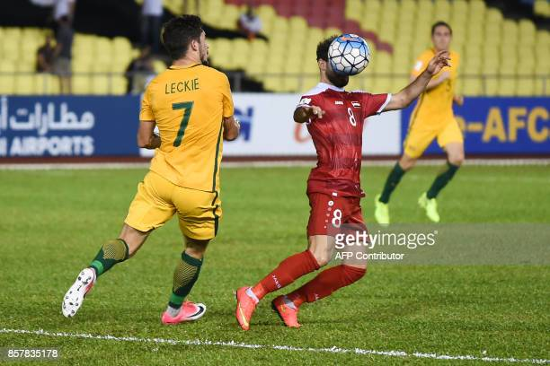 Australia's Mathew Leckie and Syria's Mahmoud alMawas compete for the ball during the 2018 World Cup qualifying football match between Syria and...