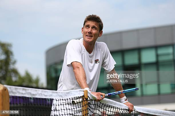 Australia's Matthew Ebden questions a line call with the umpire during a point against US player John Isner during their men's singles second round...
