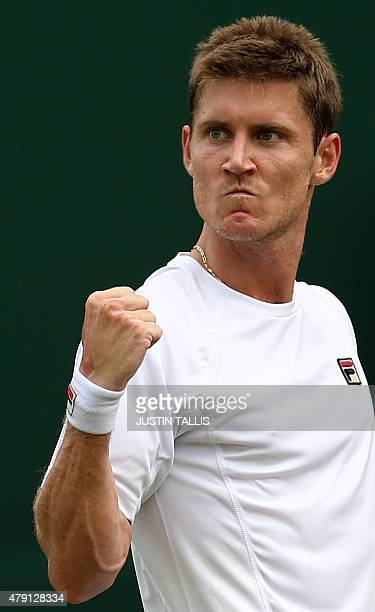 Australia's Matthew Ebden reacts after a point against US player John Isner during their men's singles second round match on day three of the 2015...