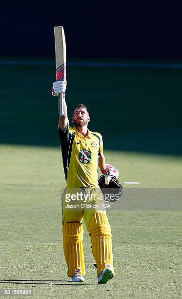 Australia's Matthew Wade celebrates his century during game one of the One Day International series between Australia and Pakistan at The Gabba on...