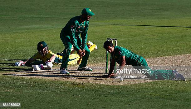Australia's Matthew Wade dives to make a run during game one of the One Day International series between Australia and Pakistan at The Gabba on...