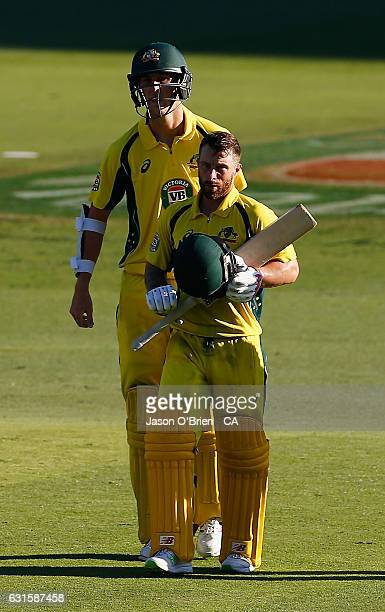 Australia's Matthew Wade walks alongside Billy Stanlake during game one of the One Day International series between Australia and Pakistan at The...