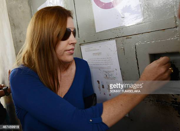 Australia's Mercedes Corby visits her sister Schapelle Corby at Kerobokan jail in Denpasar on Indonesia's resort island of Bali on February 7 2014...