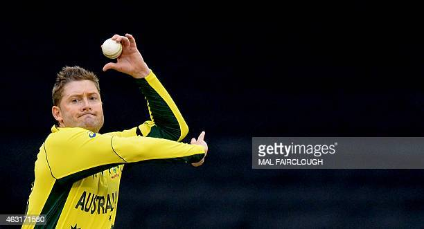 Australia's Michael Clarke bowls during the oneday international World Cup warmup cricket match between Australia and the UAE in Melbourne on...
