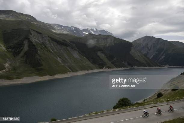 Australia's Michael Matthews Belgium's Thomas De Gendt and Spain's Daniel Navarro ride in a breakaway past a lake during the 183 km seventeenth stage...