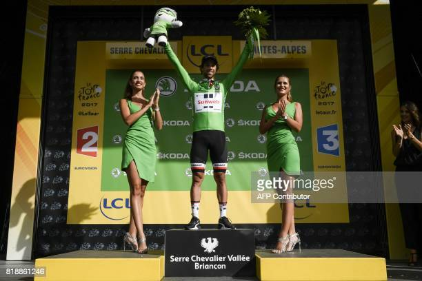 Australia's Michael Matthews celebrates his green jersey of best sprinter on the podium at the end of the 183 km seventeenth stage of the 104th...
