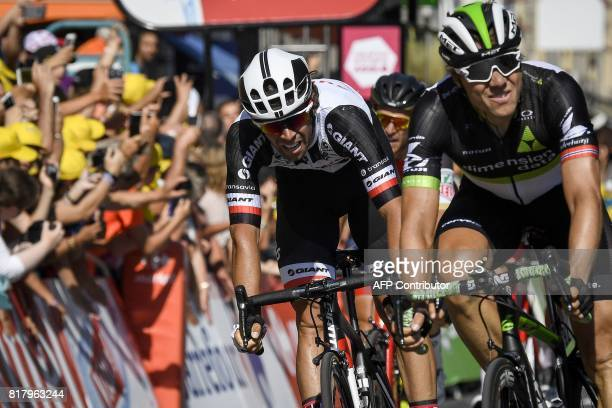 Australia's Michael Matthews crosses the finish line ahead of Norway's Edvald Boasson Hagen at the end of the 165 km sixteenth stage of the 104th...
