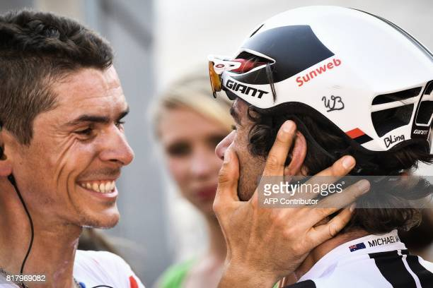 Australia's Michael Matthews is congratulated by his teammate France's Warren Barguil wearing the best climber's polka dot jersey as he won the 165...