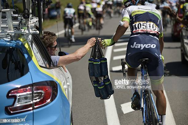 Australia's Michael Matthews takes refreshments from his team car during the 167 km tenth stage of the 102nd edition of the Tour de France cycling...