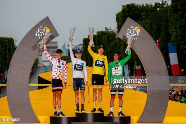 TOPSHOT Australia's Michael Matthews wearing the best sprinter's green jersey Tour de France 2017's winner Great Britain's Christopher Froome wearing...