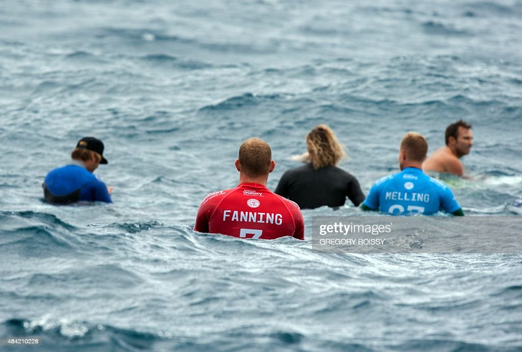 Australia's Mick Fanning floats in the sea during the kick off of the 2015 Billabong Pro Tahiti World Surf league tour no7 along the Teaupoo coast...