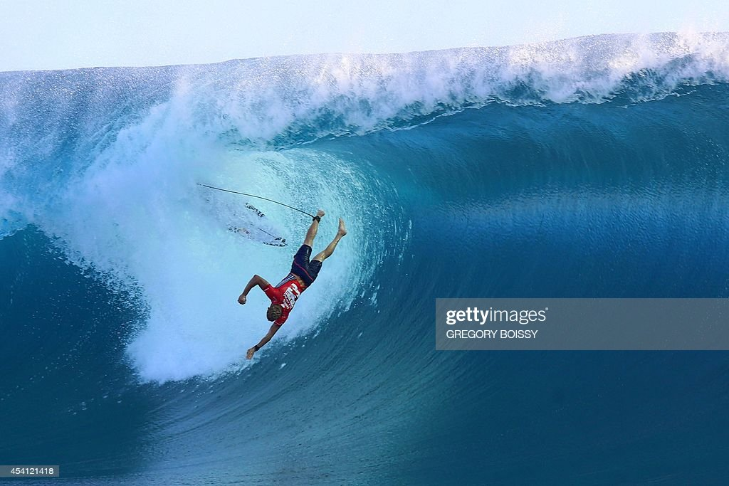 Australia's Mick Fanning wipes out during the third day of the 14th edition of the Billabong Pro Tahiti surf event part of the ASP world tour on...