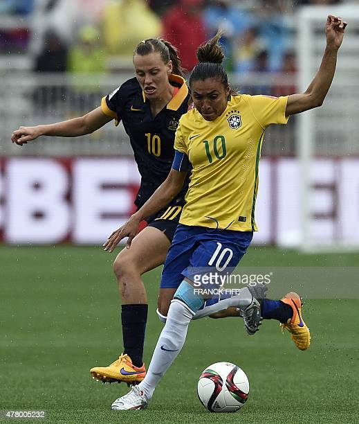 Australia's midfielder Emily Van Egmond vies with Brazil's midfielder Marta during their 2015 FIFA Women's World Cup round of 16 match between Brazil...