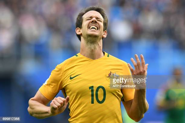 TOPSHOT Australia's midfielder Mark Milligan celebrates after scoring with a penalty during the 2017 Confederations Cup group B football match...