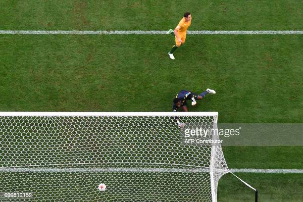 TOPSHOT Australia's midfielder Mark Milligan shoots to score in a penalty during the 2017 Confederations Cup group B football match between Cameroon...