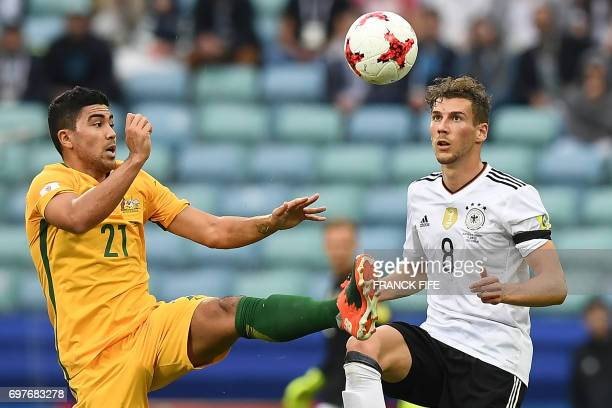 TOPSHOT Australia's midfielder Massimo Luongo fights for the ball against Germany's midfielder Leon Goretzka during the 2017 Confederations Cup group...