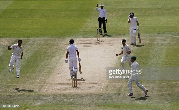 Australias Mitchell Johnson celebrates taking the wicket of Englands Captain Alastair Cook on the fourth day of the second Ashes cricket test match...