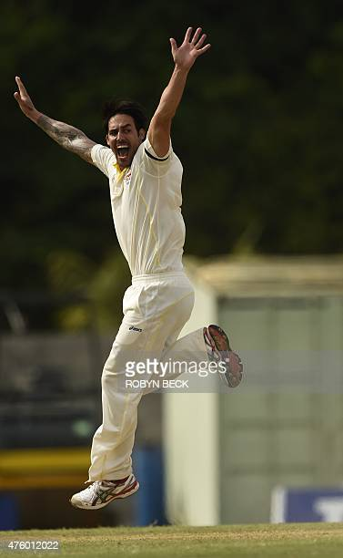 Australia's Mitchell Johnson disputes a wicket on a bowl to Marlon Samuels on the third day of the first cricket Test match between Australia and the...