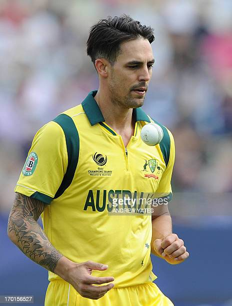 Australia's Mitchell Johnson prepares to bowl during the 2013 ICC Champions Trophy cricket match between England and Australia at Edgbaston in...