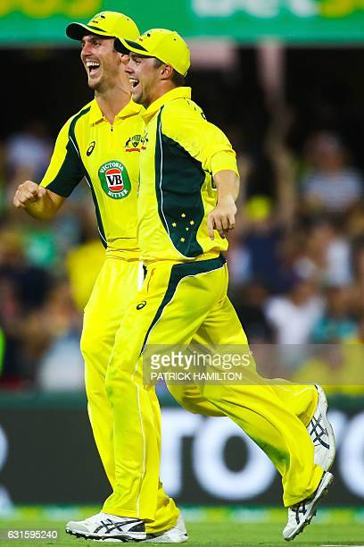 Australia's Mitchell Marsh and Travis Head celebrate the dismissal of Pakistan's Mohammad Rizwan during the oneday international cricket match...