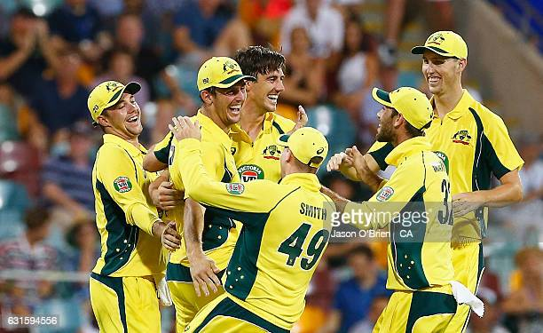 Australia's Mitchell Marsh celebrates after taking a catch during game one of the One Day International series between Australia and Pakistan at The...