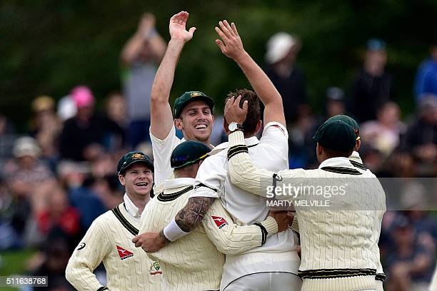 Australia's Mitchell Marsh celebrates New Zealand's Henry Nicholls being caught with teammates during day three of the second cricket Test match...
