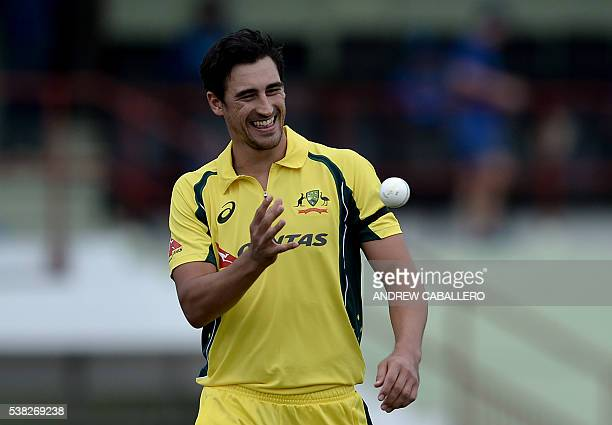 Australia's Mitchell Starc catches the ball during a Oneday International cricket match between the West Indies and Australia in the TriNation Series...