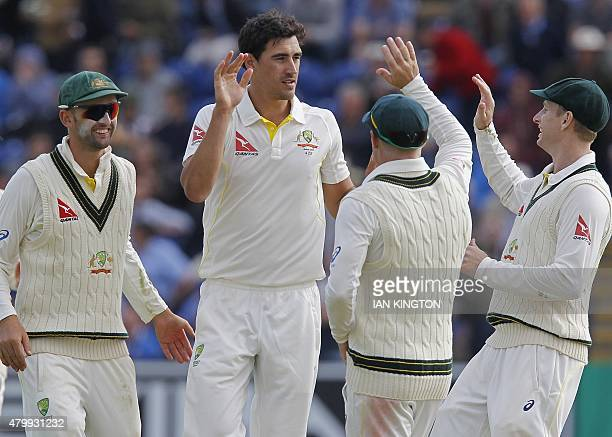 Australias Mitchell Starc celebrates taking the wicket of Englands Joe Root for 134 runs during play on the first day of the opening Ashes cricket...