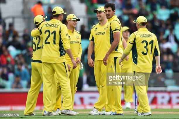 Australia's Mitchell Starc celebrates with team mates after taking the wicket of Bangladesh's captain Mashrafe Mortaza for 0 runs during the ICC...