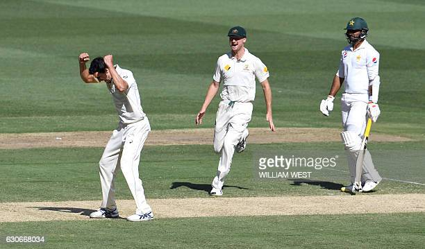 Australia's Mitchell Starc is congratulated by teammate Jackson Bird after dismissing Pakistan batsman Sarfraz Ahmed as fellow bastman Sohail Khan...