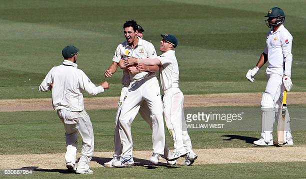 Australia's Mitchell Starc is congratulated by teammates after dismissing Pakistan batsman Sarfraz Ahmed as fellow bastman Sohail Khan looks on on...