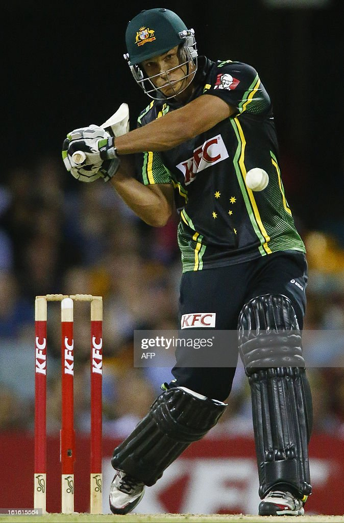 Australia's Nathan Coulter-Nile hits a shot against the West Indies during their international T20 cricket match at the Gabba cricket ground in Brisbane on February 13, 2013. AFP PHOTO / Patrick HAMILTON