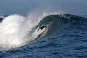 Australia's Nathan Hedges competes on August 15 2013 at the 2013 Billabong Pro Tahiti surf competition in the Hava'e pass off Teahupoo in the...