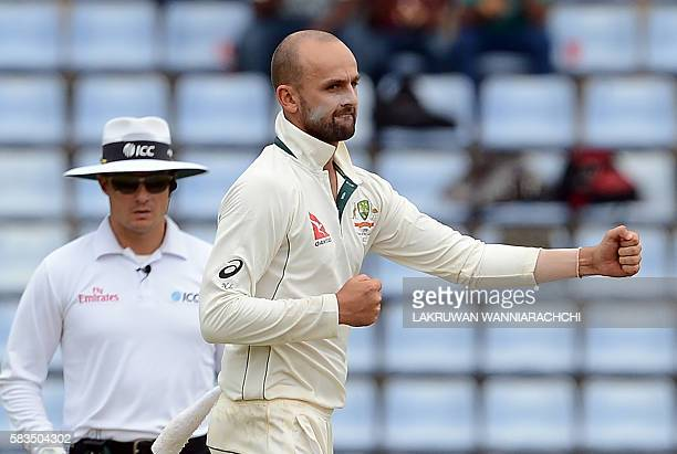 Australia's Nathan Lyon reacts after delivering a ball during the first day of the opening Test cricket match between Sri Lanka and Australia at The...