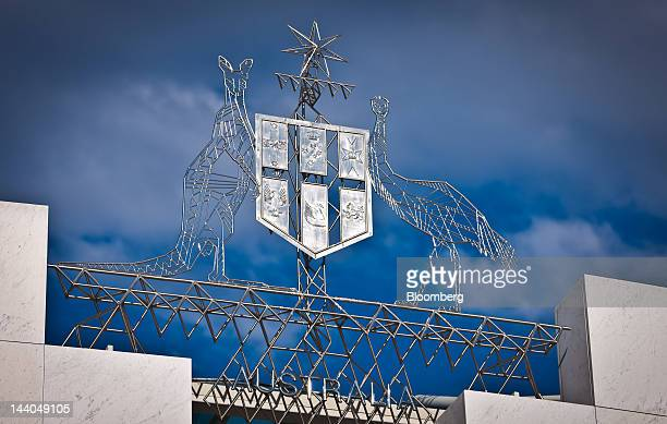 Australia's national emblem is displayed atop the Parliament House in Canberra Australia on Wednesday May 9 2012 Australia's government will cut...