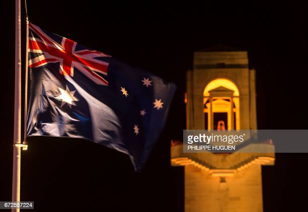 Australia's national flag flutters by the memorial rower over the military cemetery of the Australian National Memorial in VillersBretonneux northern...