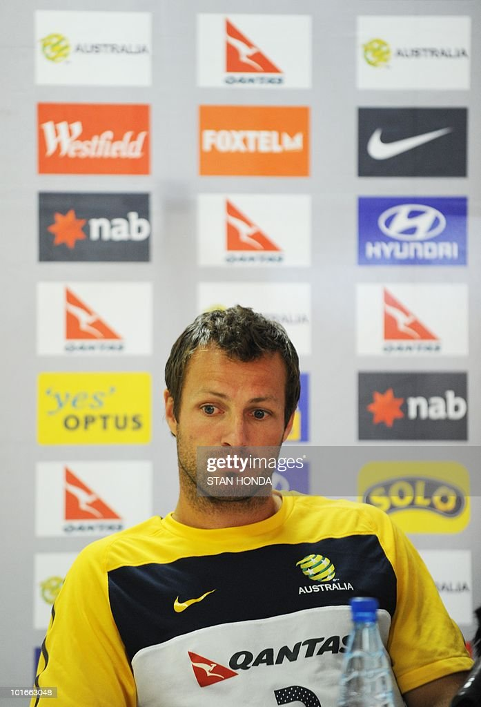Australia's national football team defender Lucas Neill reacts during a press conference ahead of the 2010 World Cup football where it was announced that goalkeeper Brad Jones will be leaving for a family emergency on June 7, 2010 in Roodeport. Jones is not expected to return for the start of the World Cup.