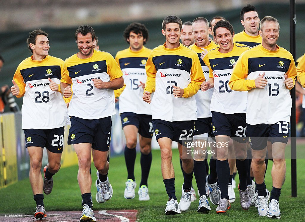Australia's national football team warms up during a team training session ahead of the start of the 2010 World Cup on June 6, 2010 in Roodepoort.