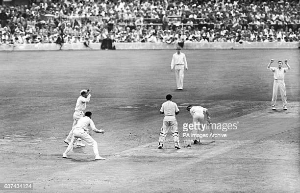 Australia's Neil Harvey is bowled by England's Jim Laker for a duck
