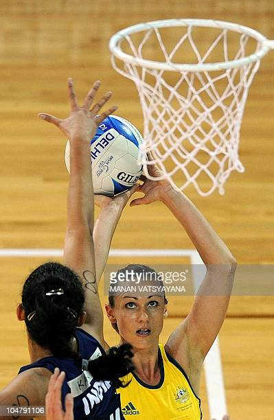 Australia's netball player Sharelle McMahon vies for the ball with India's Ramandeep Kaur during a women's group match in the XIX Commonwealth Games...