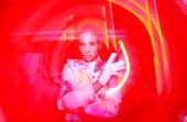 Australia's Next Top Model contestants pose against light installations during the official opening party of the Vivid Sydney Festival at the...