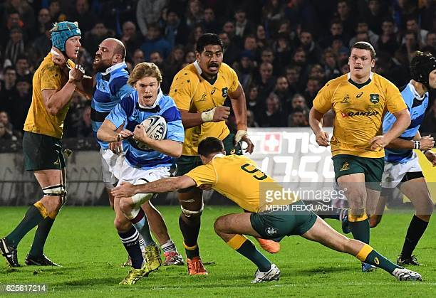 Australia's Nick Frisby tackles French Barbarians's Louis Dupichot during the rugby union friendly match between French Barbarians and Australia on...