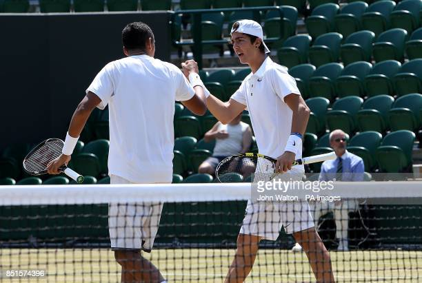 Australia's Nick Kyrgios and Australia's Thanasi Kokkinakis celebrate a point during the Boy's Doubles Final